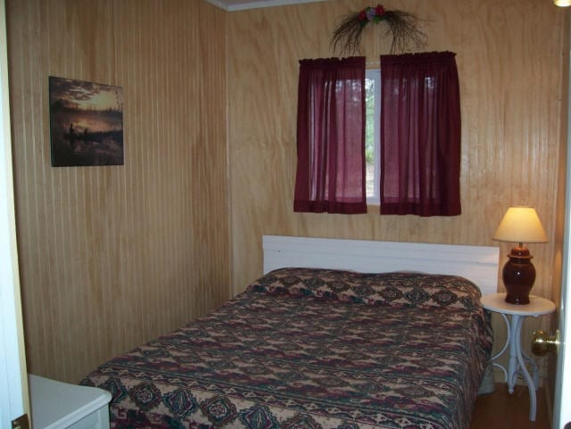Cabin bedroom with double bed.