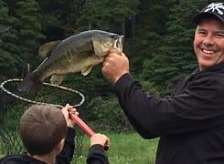 Man holding fish.
