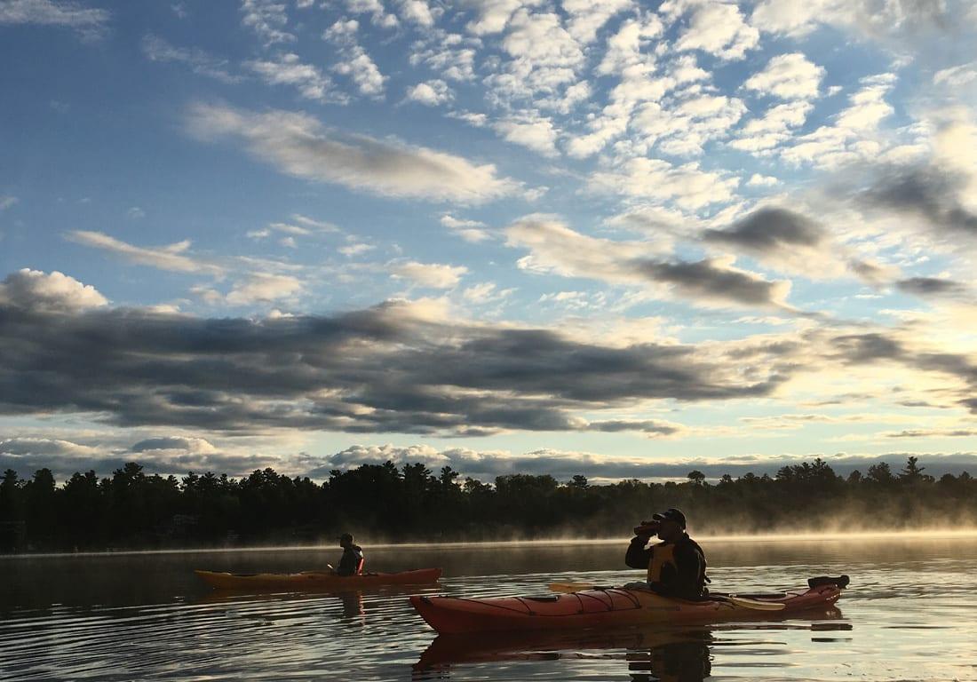 Two kayakers on lake
